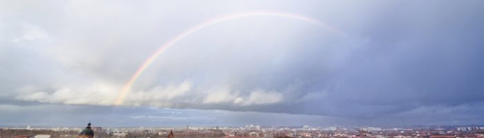 Panoramic view on a rainbow above Saint Syprien district in Toulouse, France